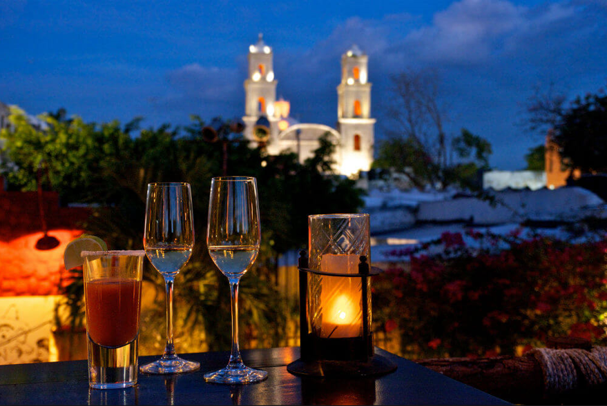 Enjoy drinks with view of the cathedral at night
